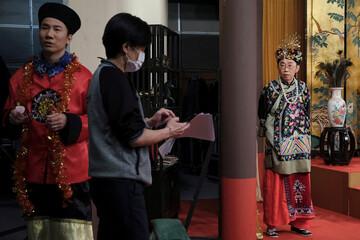 """Ng Chi-sam (L) and Tsang Chi-ho, hosts of Radio Television Hong Kong (RTHK)'s satirical comedy show """"Headliner"""" react during a show rehearsal, in Hong Kong"""