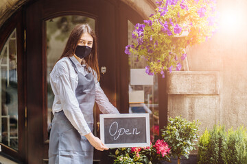 Coronavirus covid 19. Floral shop woman owner with face mask, open after lockdown quarantine. End quarantine. Announcement we are open nv doors, flower shops, cafes,coffee houses, small businesses Wall mural