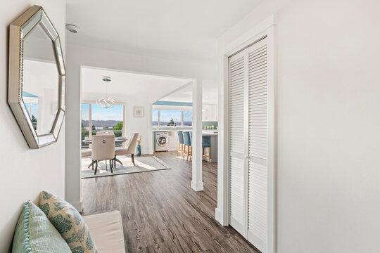 Beautiful white hallway interior with grey hardwood floors