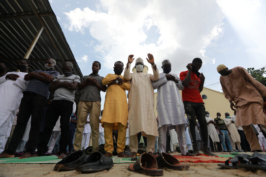 Muslim faithfuls gather to pray at a mosque, as places of worship reopen after the relaxation of restrictions imposed to curb the spread of the coronavirus disease (COVID-19) in Abuja