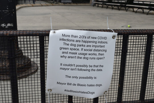 Sign questioning why the dog run is closed with the hashtag #deBlasioHatesDogs, on the fence of a dog run in a public park, June 5, 2020, in New York.