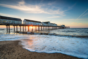 Wall Mural - A beautiful sunrise over the pretty pier at Southwold