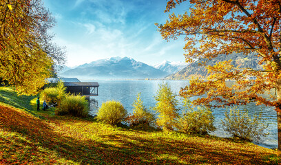 Fotomurales - Mysterious Sunset light with Zeller Lake. Wonderful Picturesque Scene. Painterly Scene in European Alps. Beautiful landscape in Alps on Zell am See, Salzburger Land, Austria