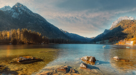 Fotomurales - Wonderful Nature Landscape. Beautiful landscape of alpine lake Hintersee under sunlight, with crystal clear green water. Amazing Autumn Sunset on Fairy-tale Lake. Awesome alpine highlands in sunny day