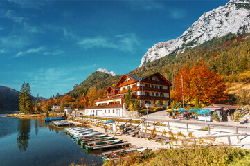 Fotomurales - Amazing sunny landscape at famouse lake Hintersee. popular travel and hiking destination. Wonderful Summer Scene with Calm Fairytale Lake under sunlight. Autumn natural scene. nature Background.