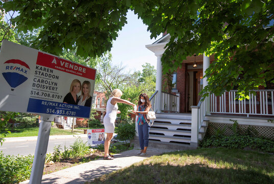 A client has her hands sanitised by real A estate agent following a visit to a home for sale, amid the coronavirus disease (COVID-19) outbreak, in Montreal