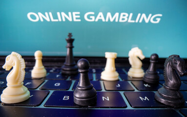 "Chess are placed on the keyboard in front of displayed ""Online Gambling"" words in this illustration picture"