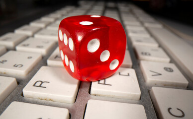 Gambling dice is seen on the keyboard in this illustration picture
