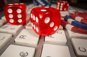 Gambling dice and chips are seen on the keyboard in this illustration picture