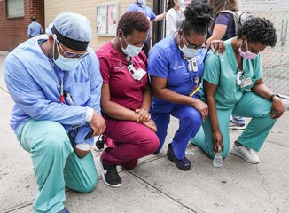 Healthcare workers take a knee out and about for Healthcare Medical Workers Protest at White Coats for Black Lives Matter Demonstration