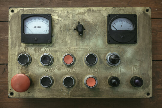 Old brass machine control panel with buttons and indicators