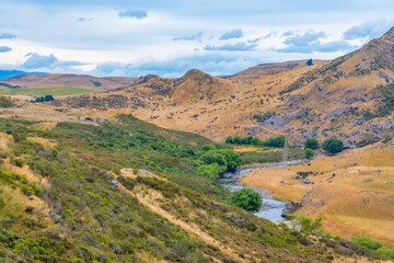 Valley of Taieri river at Central Otago Railway bicycle trail in New Zealand