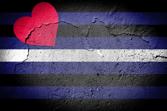 Leather Pride flag on cracked wall