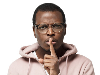 Close-up shot of angry african male with shh gesture, asking for silence or to be quiet, isolated on white background