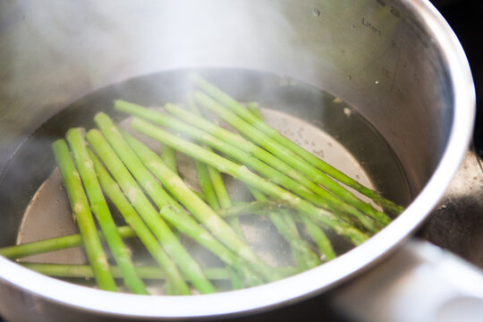 Asparagus blanched in a pan with boiling water
