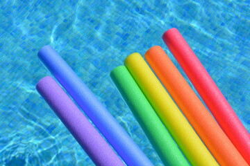 Pool noodles on swimming pool