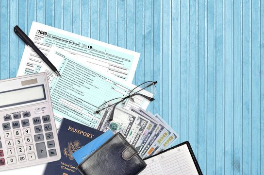 IRS form 1040 Individual income tax return lies on flat lay office table and ready to fill. U.S. Internal revenue services paperwork concept. Time to pay taxes in United States