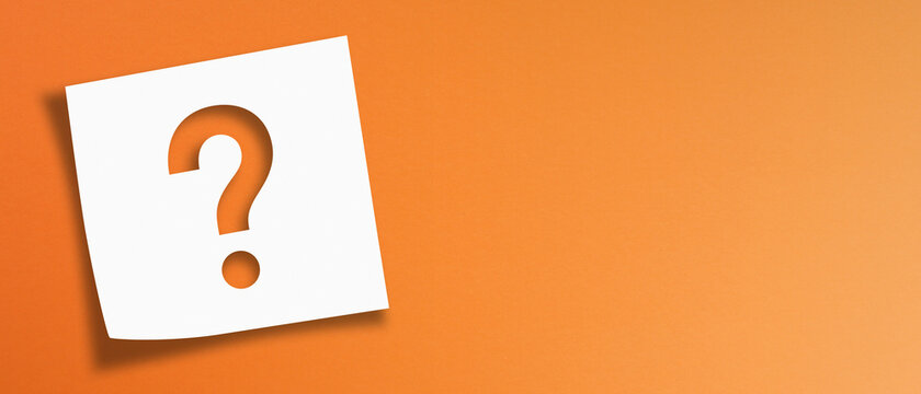 Note paper with question mark on panoramic orange background