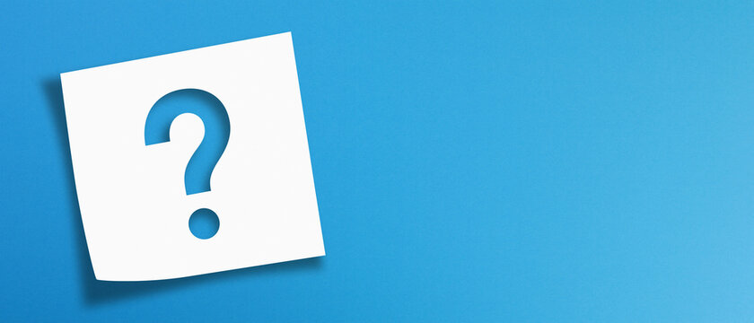 Note paper with question mark on panoramic blue background