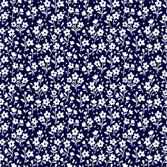 Seamless floral pattern for design. Small white flowers. Navy blue background. Modern floral texture. A allover floral design. The elegant the template for fashion prints. - 355721609