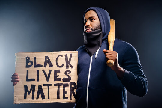 Profile side photo of afro american guy ready for african human right revolt hold baseball beat banner wear jumper isolated over black color background
