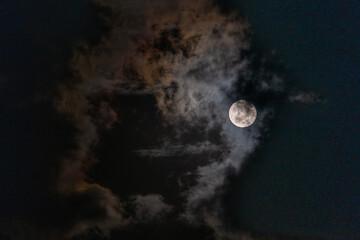 Canvas Prints Natuur Full Moon peaking through beautiful cloudscape