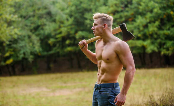 Sexy macho bare torso. Surviving in wild nature. Muscular athlete in forest. Sport and fitness. Muscular body. Brutality is sexy. Strength and power concept. Handsome shirtless man muscular body
