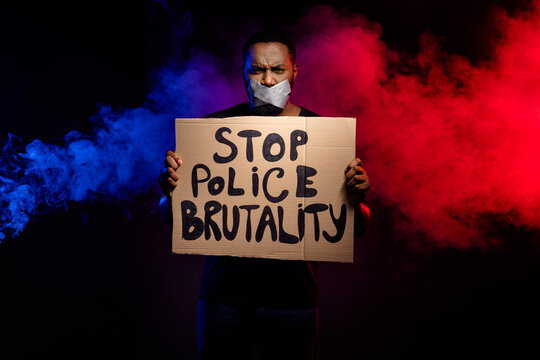 Photo of afro american guy hold paper card banner stop police brutality suffer speechless voiceless silence adhesive tape cover close lips isolated smoke black color background