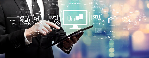 Stock trading theme with businessman using his tablet computer