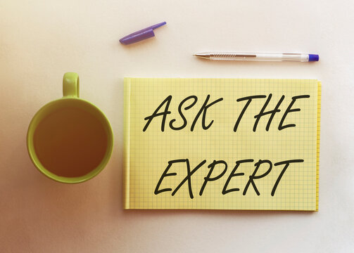 ASK THE EXPERT text on the yellow paper