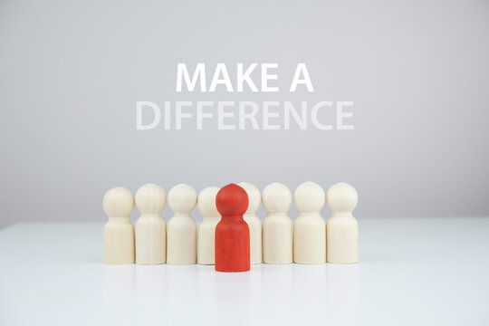 Make a difference concept, wooden figures