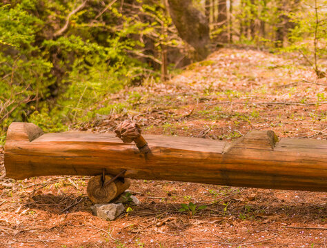 Park bench carved from log