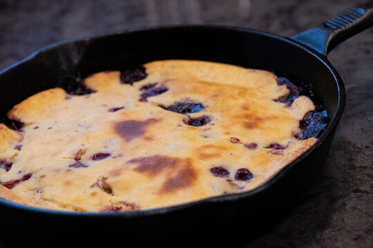 Cast iron skillet blueberry pancakes made from sourdough batter.