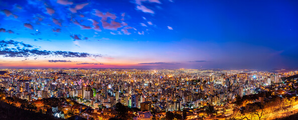 Deurstickers Bruin Panoramic Night Cityscape View During Colorful Sunset From Water Tank Lookout in Belo Horizonte, Minas Gerais State, Brazil
