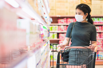 new normal after covid epidemic young smart asian female shopping new lifestyle in supermarket with...