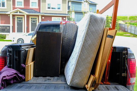 Trash items loaded on a truck to be disposed of at a landfill