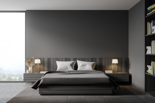 Grey master bedroom interior with bookcase