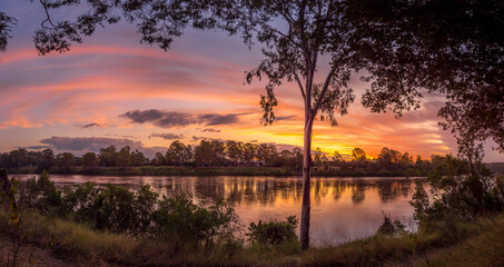 Panoramic River Sunset with Reflections