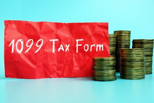 Financial concept about 1099 Tax Form with phrase on the sheet.