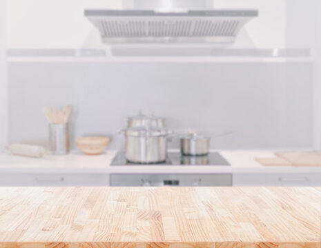 Wood table top on blur kitchen room background. can be used for display or montage your products