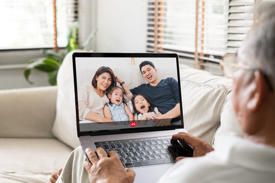 Asian old senior video call virtual meeting with family