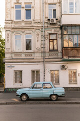 Wall Murals Havana Kyiv (Kiev), Ukraine - June 07, 2020: An old blue car (ZAZ Zaporozhets) which was very popular in 1980s in front of a prerevolutionary building