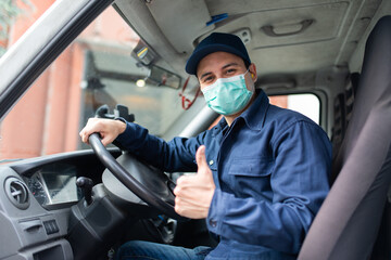 Truck driver giving thumbs up during coronavirus pandemic