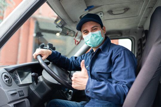 Truck driver giving thumbs up during coronavirus pandemic