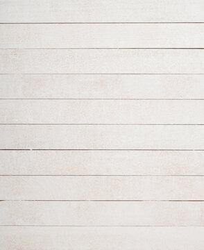 White Boards that are narrow and faux painted with a sponge for a uniquely textured background.  Boards are horizontal and the frame is vertical.