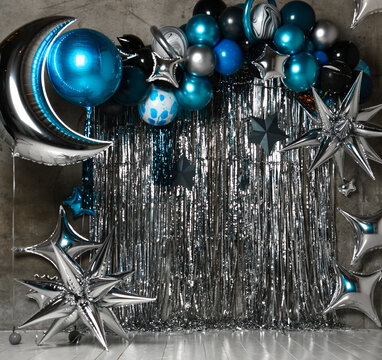 Space photo zone with blue and silver stars, ballons, large for birthday decor. Holiday decoration. Balloons
