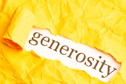 the word generosity is seen from under torn orange paper with ragged edges