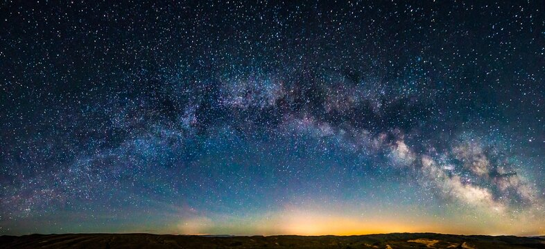 Landscape of a field under a breathtaking starry sky at night - perfect for wallpapers