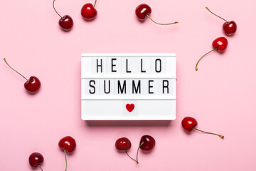 Light box with Hello Summer text and ripe cherries on pink background. Hello Summer concept