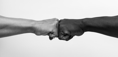 Man giving fist bump, monochrome, black and white image..